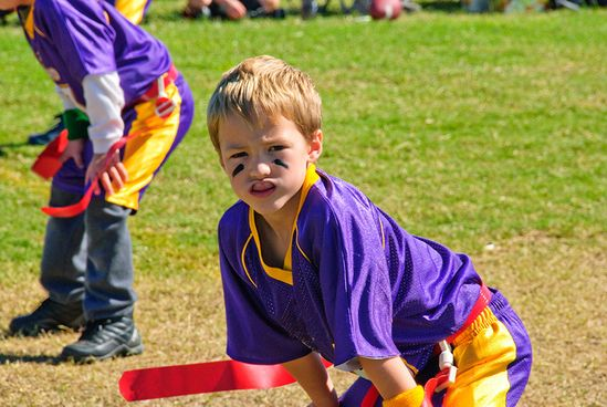 Boy playing sports with an athletic mouth guard